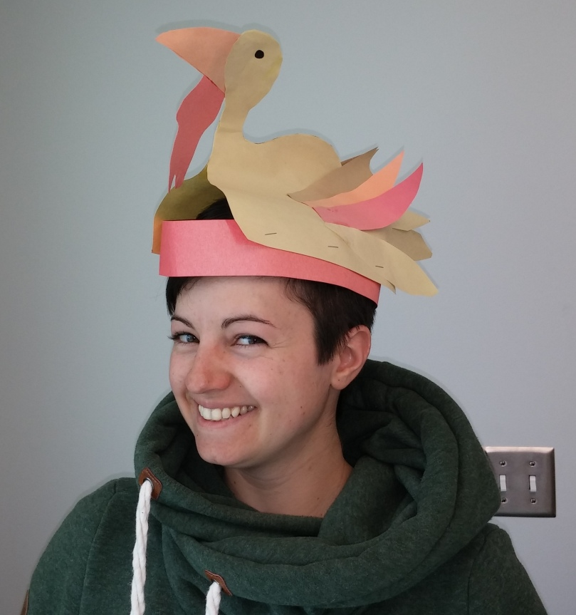 Sue wearing a paper hat shaped like a turkey.